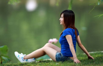 Sitting On the Grass in Sports Wear