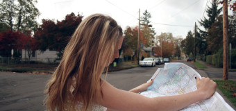 Girl Searching the Place in The Map